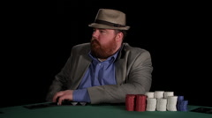 Poker player stares at camera with intimidating expressions Stock Footage