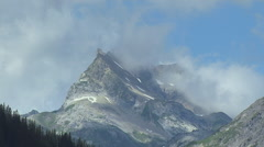 Clouds Passing over a mountain top - stock footage