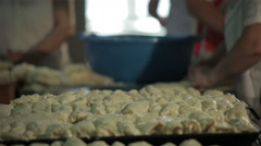 Cooks preparing cheese pies in kitchen, cooking food, shallow depth of field. Stock Footage