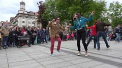 Active people in pairs dance lindy hop in street. 4K Stock Footage