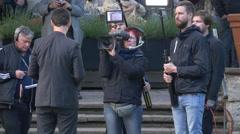 Camera crew filming an interview in front of Englischer Garten Teehaus, Berlin Stock Footage