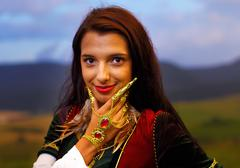 Smiling  Young woman with ornamental dress and hand jewel and finger jawel - stock photo