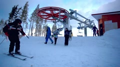Russia. Siberia. 27 december 2014. Skiers go out of ski lift in siberia Stock Footage