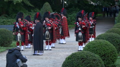 Group of men preparing to play the bagpipes in Berlin Stock Footage