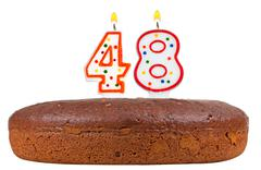 birthday cake with candles number forty eight - stock photo