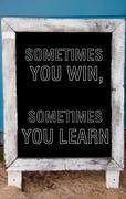 Sometimes You Win, Sometimes You Learn message written on vintage chalkboard - stock photo