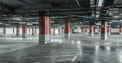 Empty underground parking background with copy space - stock photo