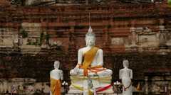 Pan Up of Statue of Buddha to Temple Top - Thailand - stock footage