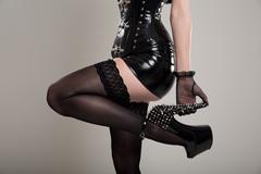Close-up shot of fetish dominatrix woman in corset Stock Photos