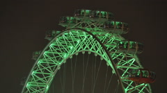 The London Eye at night in London - stock footage