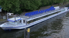 A boat with blue chairs on Spree River, Berlin Stock Footage