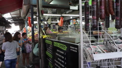 People stand in line for food stall in Carmel Market, Tel-Aviv Stock Footage