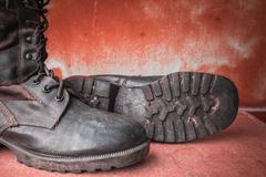 Combat boot on the  table. - stock photo