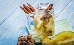infused ginger water mix of star fruit and cinnamon - stock photo