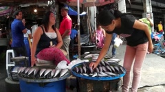 Lady picking Fish from street vendor Stock Footage