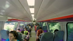 Passengers traveling on the second floor of a suburban train. Stock Footage