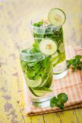 infused water mix of cucumber, lime and mint leaf - stock photo