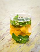 infused water mix of mango and mint leaf - stock photo