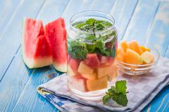 infused water mix of melon, mint leaf and watermelon - stock photo