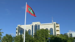 Maldivian Flag At Shaheed Hussain Adam Building, Maldives Stock Footage
