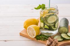 infused water mix of cucumber and lemon - stock photo