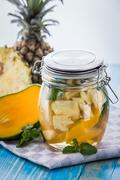 Stock Photo of infused water mix of pineapple, mango and mint leaf