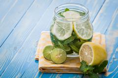 infused water mix of lime, lemon and mint - stock photo