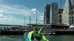 New York 345 Manhattan East River seaport speedboat departure from pier Stock Footage