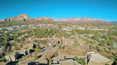 Aerial view of Sedona, Arizona and Red Rocks formations - stock footage