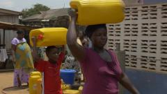 Ghana african woman carry water steady 4K Stock Footage