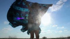 Little girl holding beach towel in wind - Dirty lens effect Stock Footage