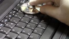 IT specialist inspecting laptop computer Stock Footage
