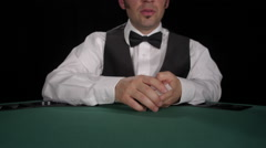 CU of dealer dealing and revealing board cards of Texas Hold 'em / Omaha Stock Footage