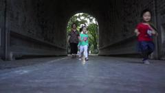 Kids running through ancient citygate  of Imperial Palace of Ming Dynasty Stock Footage