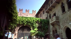 ULTRA HD 4K real time shot,Unidentified tourists near Juliet's statue in Verona Stock Footage