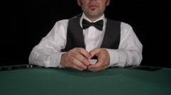 CU of dealer shuffling cards and then dealing Stock Footage