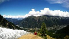 Stock Video Footage of running in the chamonix valley near the glacier and alpine meadow