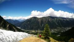 Stock Video Footage of hiking and tracking in the chamonix valley near the glacier and alpine meadow
