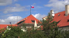 Flags of the Czech Republic and the European Union over the red roofs of Prague Stock Footage