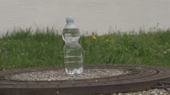 Plastic Bottle Of Water Being Hit By Plastic Bullet Stock Footage
