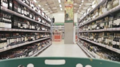 grocery shopping in a supermarket with a trolley - stock footage