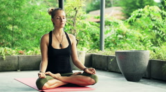 Young, beautiful woman meditating yoga at terrace HD - stock footage