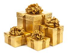 Stock Photo of Gift boxes of gold color isolated on white background