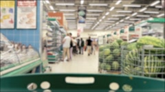 Grocery shopping in a supermarket Stock Footage