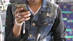Smart Fashionable Teenage Girl Listens To Music From Her Gold Smart Phone Stock Footage