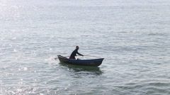 Vietnamese fisherman rows in boat using paddle Stock Footage