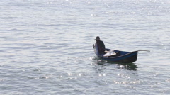 Vietnamese fisherman pulls empty net out of water Stock Footage