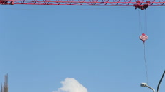 Crane jib turns and carriage starts to move Stock Footage