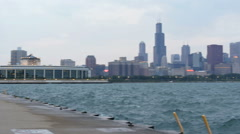 Pan from Chicago skyline out to Lake michigan on a cloudy grey day Stock Footage
