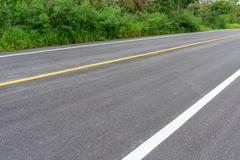 Road asphalt texture with separation lines Stock Photos